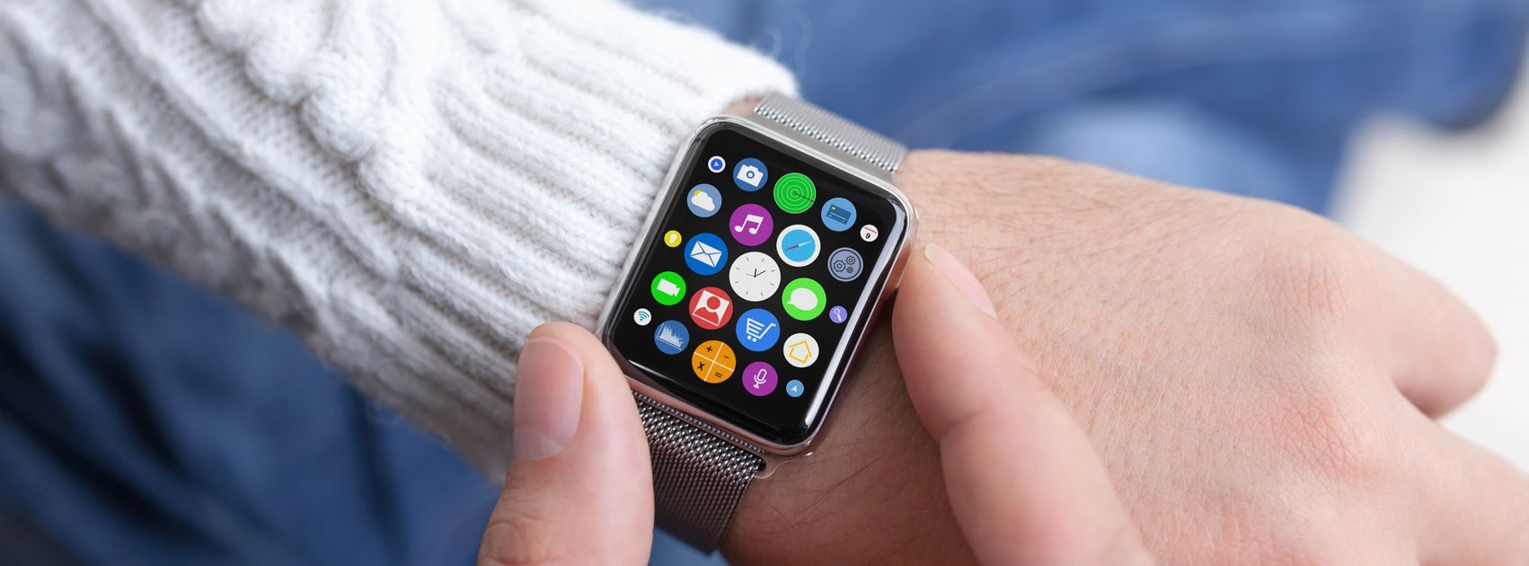 Man hand and Apple Watch with app on the screen. Apple Watch was created and developed by the Apple inc.